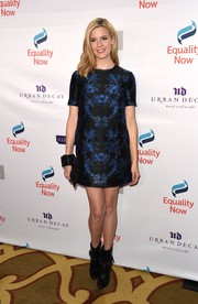 Maggie Grace contrasted her ladylike frock with tough-looking studded boots.