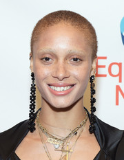 Adwoa Aboah balanced out her edgy 'do with some ultra-girly earrings.