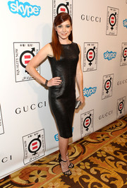 Alyson Hannigan played up her enviably svelte figure in a black leather sheath dress during the Make Equality Reality event.