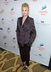 Melanie Griffith opted for a mannish dark-plum pantsuit when she attended the Make Equality Reality Gala.