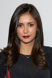 Nina Dobrev was fabulously coiffed with this glossy side-parted 'do with feathery ends at the Body Spectacle exhibition.
