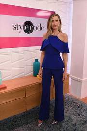 Sara Foster rocked the cold-shoulder trend with this cobalt peplum jumpsuit by Christian Siriano while visiting Amazon's 'Style Code Live.'