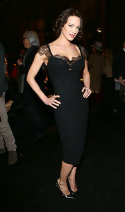 Asia Argento attended the Fall 2013 presentation of Ermanno Scervino wearing a gorgeous LBD with lace cap sleeves and neckline detailing.