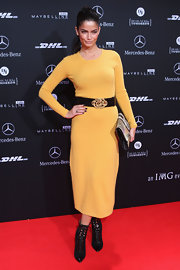 Shermine Sharivar looked vibrant and cozy in a yellow knit dress for the Escada show in Berlin.