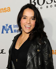 Michelle Rodriguez sported a youthful wavy 'do with bangs at the grand opening of Esquire House LA.