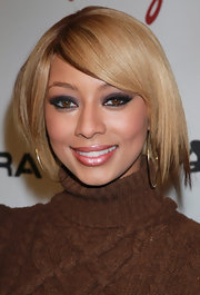 Keri Hilson drew our attention to her almond shaped eyes with bold false lashes. It was the perfect way to highlight her hazel eyes.
