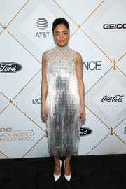 Tessa Thompson went for simple styling with a pair of white Christian Louboutin pumps.
