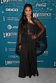 Laverne Cox was sexy-glam in a caped mesh-panel halter gown by Rohit and Rahul at the Essence Black Women in Hollywood Awards.