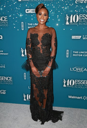 A pearlized silver box clutch by Edie Parker sealed off Issa Rae's look.