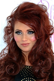 Amy Childs wore her rich red hair with loads of body and big curls while attending Essex Fashion Week.