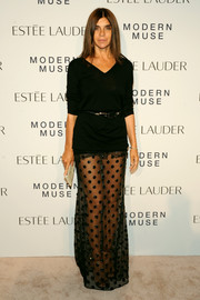 Carine Roitfeld oozed sexy sophistication in a black V-neck sweater teamed with a sheer skirt during the Estee Lauder fragrance party.