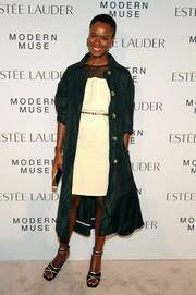 Shala Monroque teamed black and gold platform sandals with a teal coat and a white dress for the Estee Lauder fragrance party.