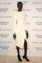 Alek Wek kept it classic in a long-sleeve white dress during the Estee Lauder fragrance party.