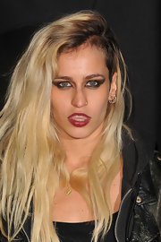 Alice Dellal added polish to her pout with this rich berry lipstick.