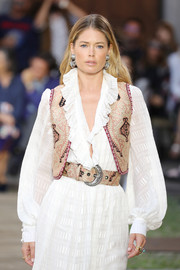 Doutzen Kroes wore a patterned vest over a white ruffle dress while walking the Etro Spring 2020 runway.