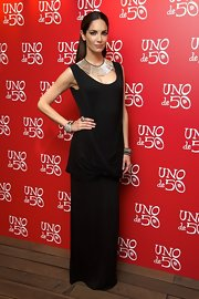 Eugenia wore this black draped column dress to the 'Uno de 50' event in Madrid.