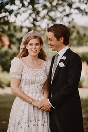 Princess Beatrice was a vintage beauty for her private wedding ceremony. She chose to wear an embellished gown from Queen Elizabeth (but with the addition of sleeves!) for her special day.