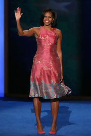 Michelle Obama completed her sweet look with a pair of pink pumps.