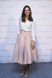 Eva Gonzales paired her top with a '50s-style flared gingham skirt.