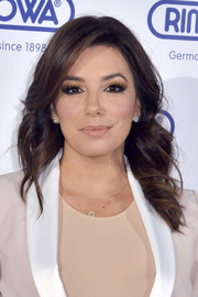 Eva Longoria gave a loose wavy style at the Miami store opening of Rimowa.