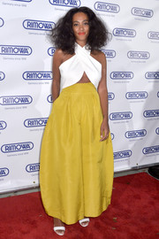 Solange Knowles bravely wore extremely oversized Rosie Assoulin pants in a muted yellow hue to the Rimowa store opening.