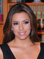 Eva Longoria added some flirt to her look with lengthy defined lashes.