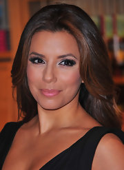 Eva Longoria wore sparling pink lip gloss to the signing of her new book 'Eva's Kitchen.'