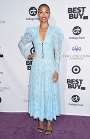 Zoe Saldana kept it prim and proper in a pastel-blue lace dress by Erdem at the Eva Longoria Foundation dinner.