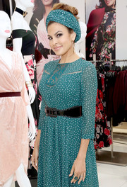 Eva Mendes spotlighted her tiny waist with an oversized whipstitch belt during the launch of her Fall collection.