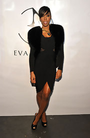 Kelly donned a fur vest over her sleek LBD at the Eva Minge fashion show in New York.