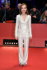 Isabelle Huppert shone in a beaded silver pantsuit by Roberto Cavalli at the Berlinale premiere of 'Eva.'