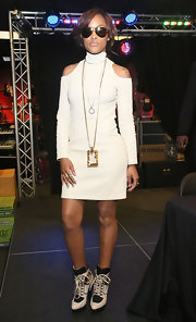 Eve rocked this long-sleeve turtleneck mini dress that featured cold-shoulder detailing while at an album signing.