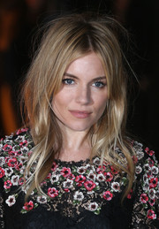 Sienna Miller's wavy tresses looked a little messy when she attended the Global Fund event.