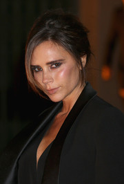 Victoria Beckham looked smoldering with her messy-glam updo and smoky eyes at the Global Fund event.