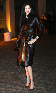 L'Wren Scott bundled up in style with a black leather coat at the Global Fund event.