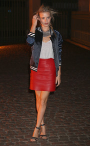 Georgia May Jagger sported a youthful vibe with this black track jacket and red mini skirt combo during the Global Fund event.