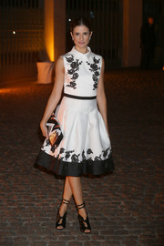 Livia Giuggioli was a charmer in this black-and-white floral cocktail dress at the Global Fund event.