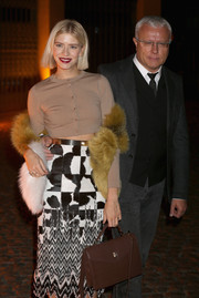 Elena Perminova was on trend in a beige crop-top paired with a black-and-white print skirt during the Global Fund event.