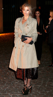 Laura Bailey arrived at the Global Fund event wearing a classic beige trenchcoat over a sparkly dress.