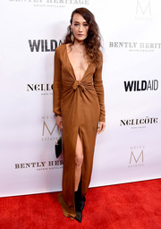 Maggie Q looked va-va-voom in a plunging, high-slit tan gown by Bert Keeter at the Evening in China with WildAid event.