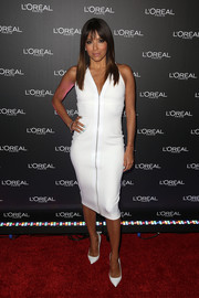 A pair of Christian Louboutin pointy pumps sealed off Eva Longoria's all-white look.