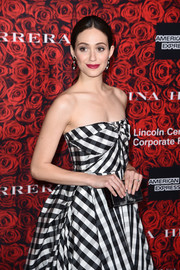 Emmy Rossum attended the Evening Honoring Carolina Herrera event sporting a black velvet box clutch and strapless gown combo.