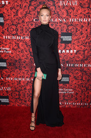 Romee Strijd styled her gown with strappy black heels.