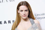 Riley Keough went for a simple straight cut with a center part at the Evening Honoring Louis Vuitton event.