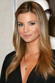 Amber Lancaster showed off her California glow while donning her signature long highlighted tresses. She pinned her bangs back to one side to open up her face.