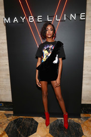Jourdan Dunn injected a bright pop with a pair of red patent boots.