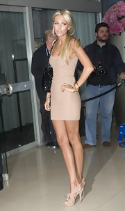 Petra Ecclestone shows off her figure in this nude-colored mini cocktail dress.