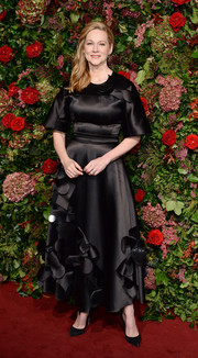 Laura Linney looked playfully elegant in a petal-appliqued satin gown by Roksanda at the 2018 Evening Standard Theatre Awards.