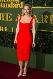 Gillian Anderson looked ageless in a form-fitting red dress during the Evening Standard Theatre Awards.