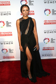 Kat Graham cut a sultry figure at the Evening with Women benefit in a black Cengiz Abazoğlu gown with a mesh-panel bodice and a thigh-high slit.